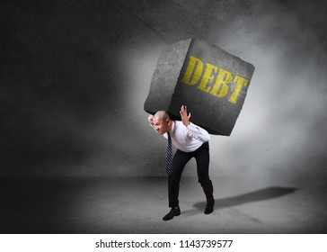 Composite image. Stress pressure of debt in business concept. Businessman walking and carrying heavy stone on his back. Grunge background