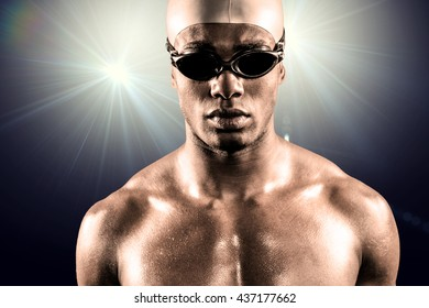 Composite image of swimmer ready to dive against spotlight