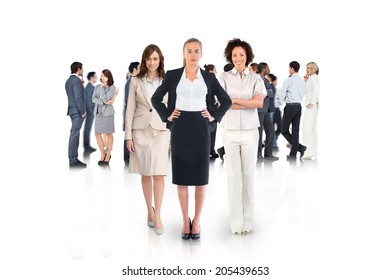 Composite image of team of businesswomen looking at camera on white background