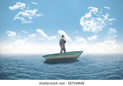 Composite image of thinking businessman in a sailboat in the ocean