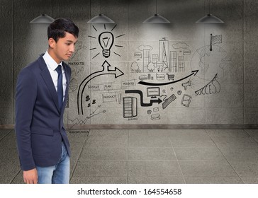 Composite image of unsmiling casual businessman walking