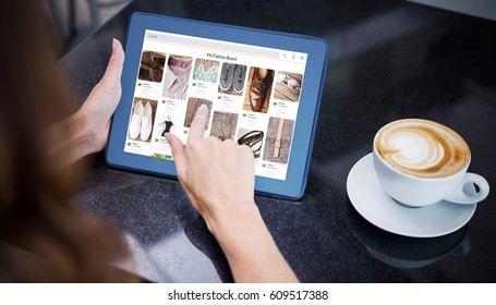 Composite image of website page against woman having coffee and using her tablet
