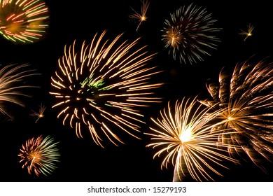 A composite of interesting bursting fireworks.
