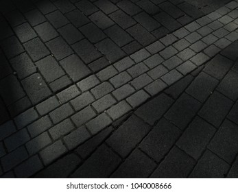 Composite of paving stones floor path in various directions grey white background texture pavement