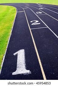 Composite running track at high school stadium