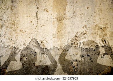 A composite of two terrified shadows on a war torn grunge wall. This can be used for the Syrian conflict or any war. Plenty of room for your title on top of the shadows.