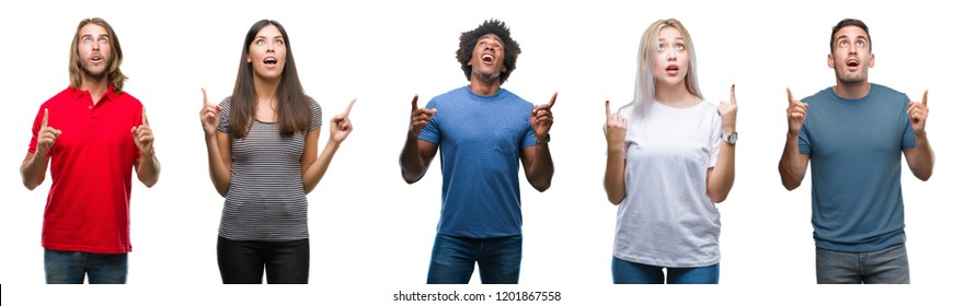 Composition of african american, hispanic and caucasian group of people over isolated white background amazed and surprised looking up and pointing with fingers and raised arms.