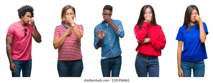 Composition of african american, hispanic and chinese group of people over isolated white background smelling something stinky and disgusting, intolerable smell, holding breath with fingers on nose.