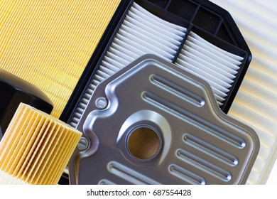 composition of air filters for car engine on a white background