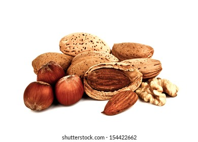 Composition of almonds, walnuts and hazelnuts isolated on white background.