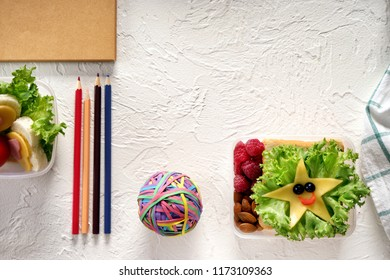 Composition with appetizing food for schoolchild and stationery on light background