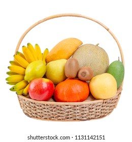 Composition with assorted fruits in wicker basket, balanced diet on white wood background