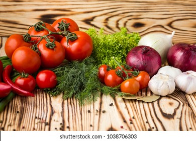 Composition with assorted raw organic vegetables such as tomatoes, sweet peppers, herbs, onions and garlic. Detox diet