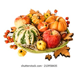 Composition with Autumn leaves, pumpkins and berries. Happy Thanksgiving!