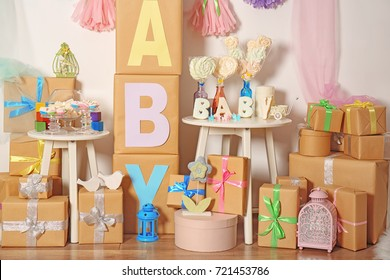 Composition with baby shower decorations and gifts indoors