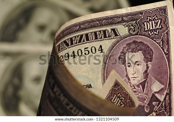 The composition of the banknotes of the Venezuelan Bolivar and the US dollar. Economic and political issues in financial terms. Dollar. Bolivar. Venezuela. USA.