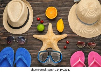Composition with beach accessories on wooden background