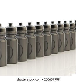 Composition of black plastic drinking sport bottles arranged in a line, over the white reflective surface