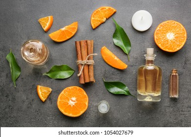 Composition with bottles of citrus essential oil on table, top view