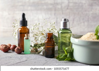 Composition with bottles of essential oils on table. Natural cosmetics