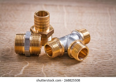 Composition Of  Brass Pipe Connectors On Wooden Board