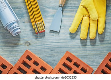 Composition of bricklaying tools on wooden board construction co
