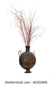 Composition of brown decorative vase filled with red artificial branches