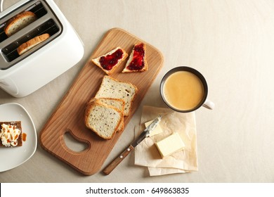 Composition with butter coffee and toasts on kitchen table