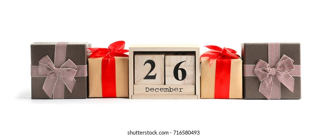 Composition with calendar and gift boxes, isolated on white