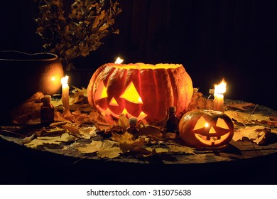 The composition of the candles, pumpkins and maple leaves. Decor for Halloween.