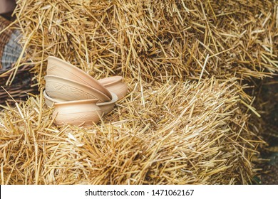 Composition with ceramic bowls on haystack. Conception old rustic style. Shallow depth of the field, copy space for you text.