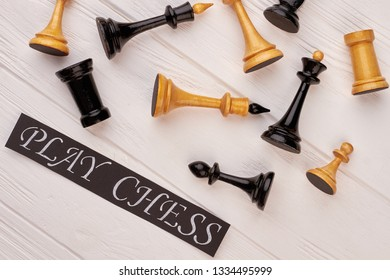 Composition of chess figures. Flat lay chess figures and card with inscription play chess.