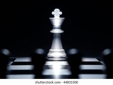 Composition from chessmen on a black background
