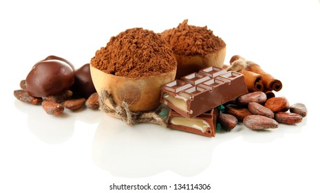 Composition of chocolate sweets, cocoa and spices, isolated on white