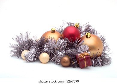 Composition of Christmas balls and tinsels on white
