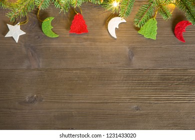 Composition of Christmas decorations, with fir branches and lights, ideal as a background
