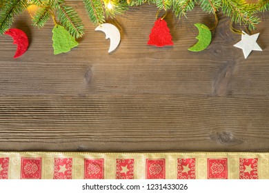 Composition of Christmas decorations, with fir branches, cloth and lights, ideal as a background