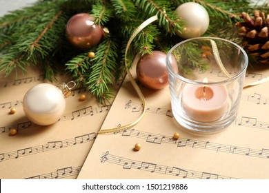Composition with Christmas decorations on music sheets, closeup