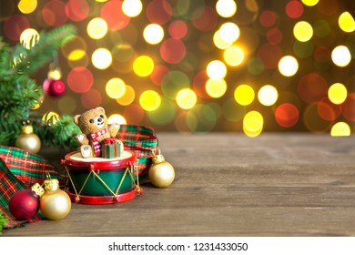 Composition of Christmas decorations, with teddy bear, glass balls, fir branches and cloth