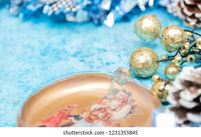 Composition Christmas holidays Christmas toys on a blue background with Christmas decorations. A bunch of Christmas toys and tinsel, while happy waiting for the New Year holidays. New Year card