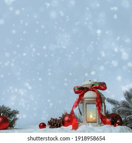 Composition with Christmas lantern on snow, space for text. Bokeh effect