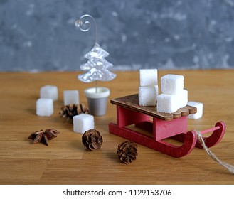 A composition of Christmas toys for Christmas and New Year holidays on a wooden background. Concept of Christmas and New Year holidays