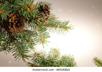 Composition with Christmas tree and Christmas decoration balls, cones, beads.