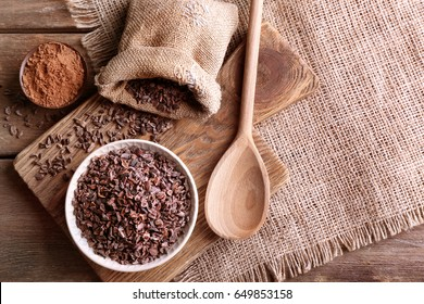 Composition with cocoa nibs on table