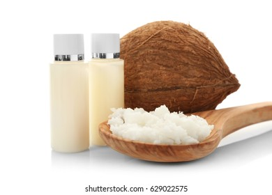 Composition with coconut butter in wooden spoon and nut on white background