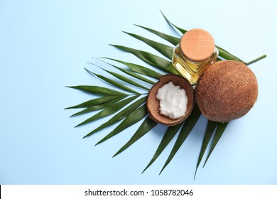 Composition with coconut oil on color background