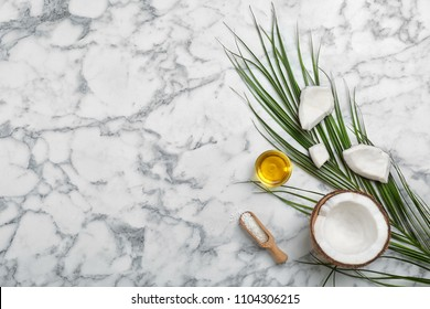 Composition with coconut oil on marble table, top view. Healthy cooking