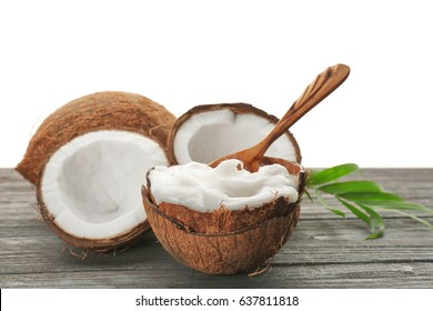 Composition with coconut oil in shell on wooden table