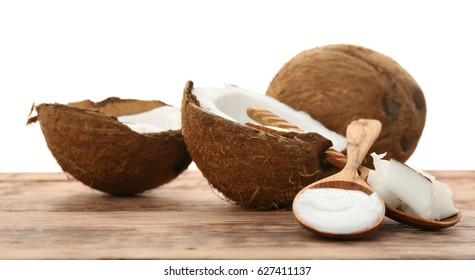 Composition with coconut on wooden table