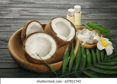 Composition with coconuts and oil on wooden background